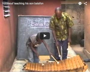 Youssouf Teaching His Son Balafon