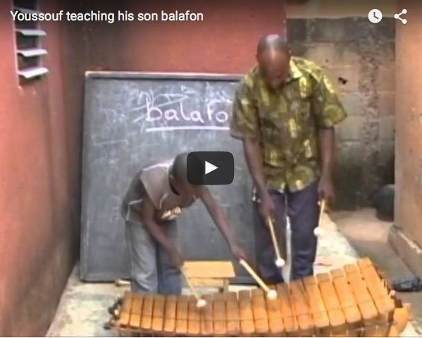 Youssouf Teaching His Son Balafon